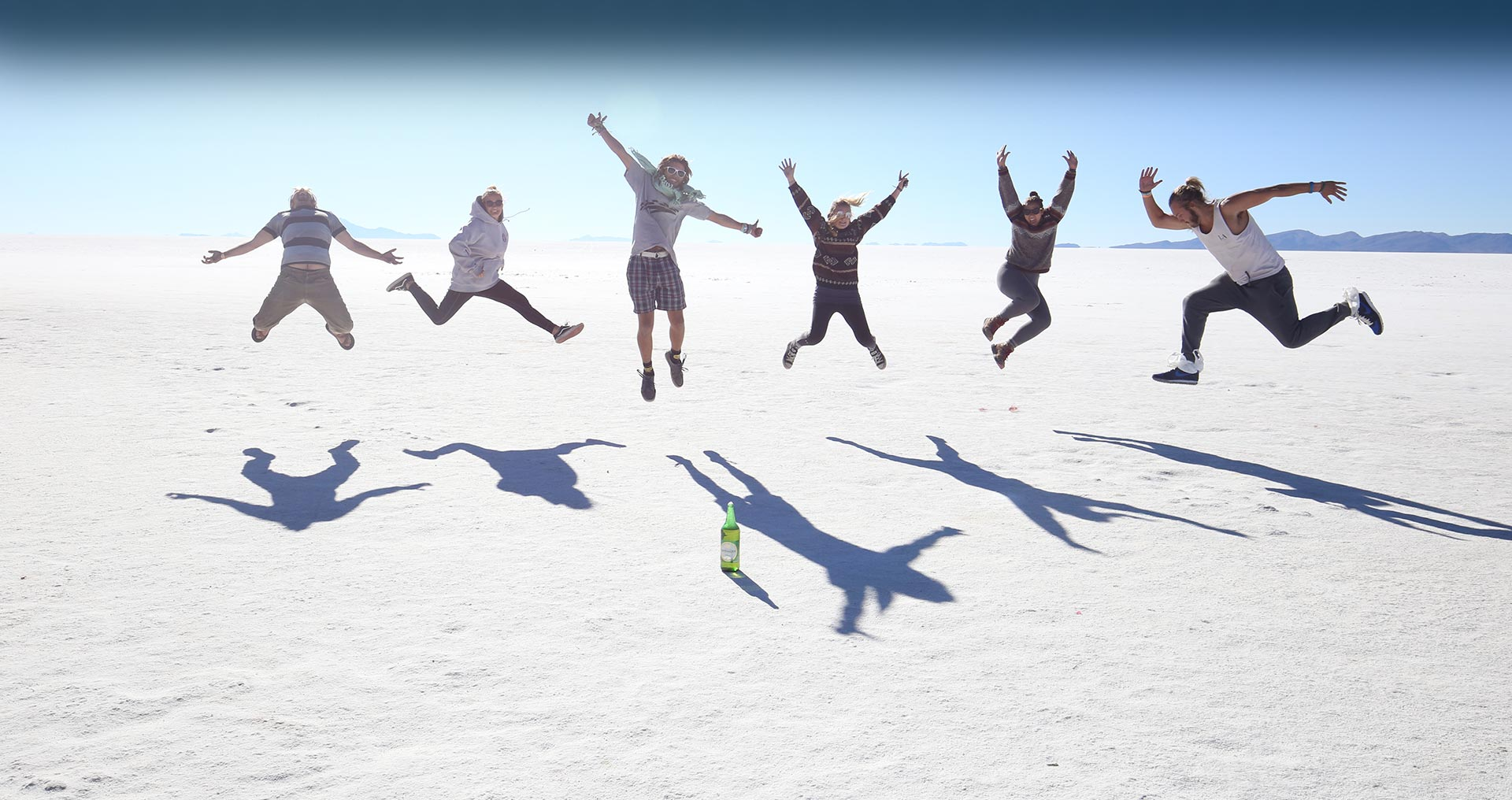 Global Convoy jump for joy in the salt flats