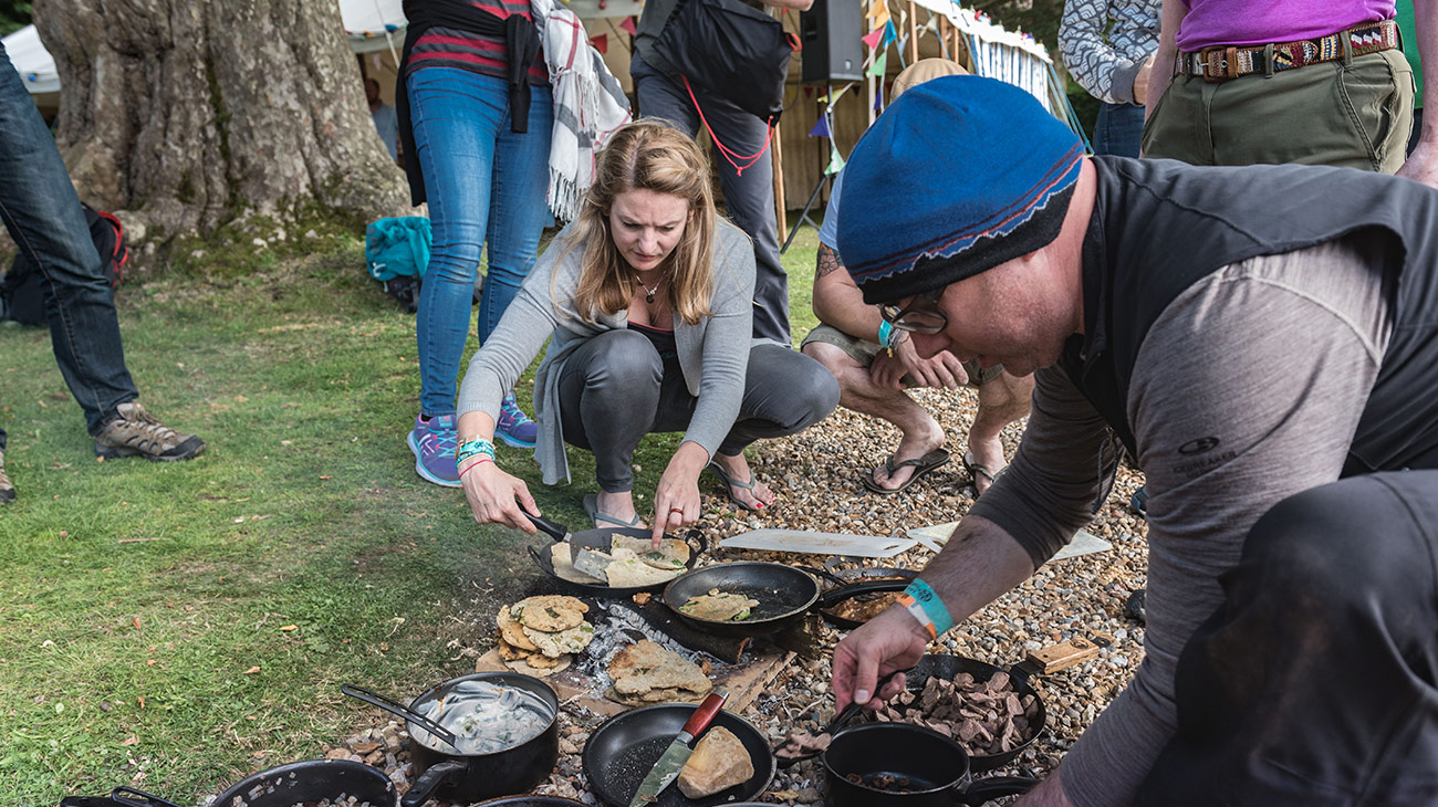Keran Creevey cooking on a camfire at the Adventure Travel Film Festival