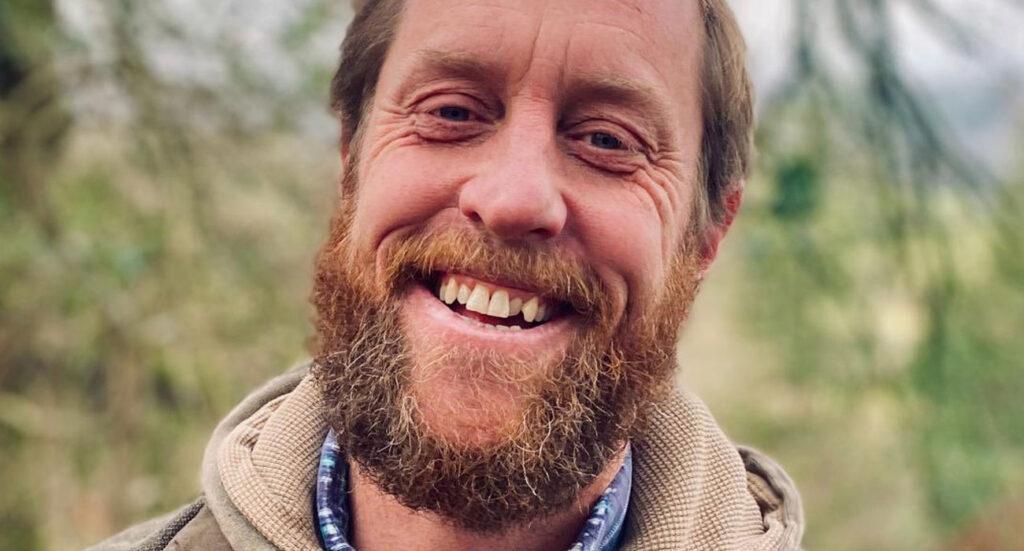 Adam Thompson smiling